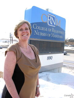 Cathy Rippin-Sisler outside the College of Registered Nurses of Manitoba, located at 890 Pembina Hwy.