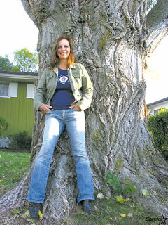 St. Vital resident Cathy Haining in her front yard with her Carolina poplar tree.