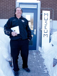 CHS president Len Van Roon, seen here in March next to his dad's homemade museum sign, says there will be free ice cream while supplies last.