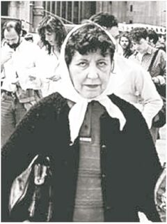 Angélica Sosa de Mignone in the distinctive white scarf of the Mothers of Plaza de Mayo.