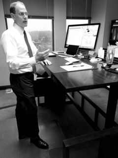 Office workers, such as executive Jeff Schwarz in Kansas City, are starting to stand, instead of sit, at work.