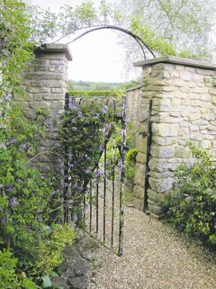 Ancient gates, such as this one photographed on a visit to the English Cotswolds, enchant visitors.