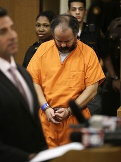 Ariel Castro enters the courtroom during his arraignment on an expanded 977-count indictment Wednesday, July 17, 2013, in Cleveland. Castro is charged with kidnapping and raping three women over a decade in his Cleveland home. He pleaded not guilty to 512 counts of kidnapping and 446 counts of rape. (AP Photo/Tony Dejak)
