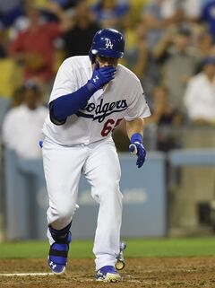 Los Angeles Dodgers Joc Pederson reacts after getting the third strike for the last out in the bottom of the ninth inning of a baseball game against the Washington Nationals, Monday, Sept. 1, 2014, in Los Angeles. The Nationals won 6-4. (AP Photo/Gus Ruelas)
