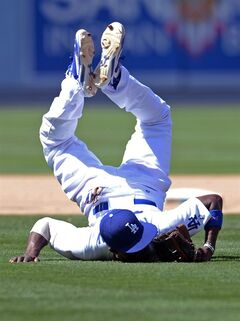Los Angeles Dodgers' Dee Gordon lands on his face after making a play and throwing out Arizona Diamondbacks' Tony Campana at first base in the eighth inning in of a baseball game, Sunday, June 15, 2014, in Los Angeles. (AP Photo/Jayne Kamin-Oncea)