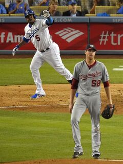 Los Angeles Dodgers' Juan Uribe, left, and Washington Nationals starting pitcher Doug Fister watch Uribe's two-run home run during the sixth inning of a baseball game, Tuesday, Sept. 2, 2014, in Los Angeles. (AP Photo/Mark J. Terrill)