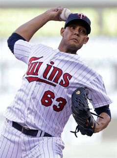 Minnesota Twins pitcher Yohan Pino throws against the Kansas City Royals in the first inning of a baseball game, Monday, June 30, 2014, in Minneapolis. (AP Photo/Jim Mone)