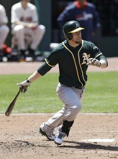 Oakland Athletics' Brandon Moss watches his ball after hitting an RBI double off Cleveland Indians starting pitcher Justin Masterson in the fifth inning of a baseball game, Sunday, May 18, 2014, in Cleveland. Coco Crisp scored. (AP Photo/Tony Dejak)