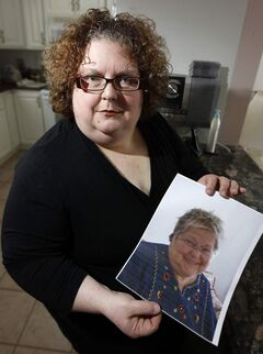 Dana Brenan holds a photo of her mother, Heather Brenan, who died Jan. 28, 2012 from a bilateral pulmonary embolism.