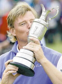 Ernie Els of South Africa kisses the Claret Jug trophy after winning the British Open Golf Championship at Royal Lytham & St Annes golf club, Lytham St Annes, England Sunday, July 22, 2012. (AP Photo/Chris Carlson)