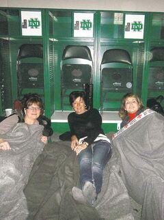 SUBMITTED PHOTO Marcia Desmedt, Ola Fedorkiw and Heather Black (from left) bed down in arena.
