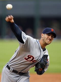 Detroit Tigers starting pitcher Rick Porcello delivers against the Chicago White Sox during the first inning of a baseball game on Monday, June 9, 2014, in Chicago. (AP Photo/Jeff Haynes)