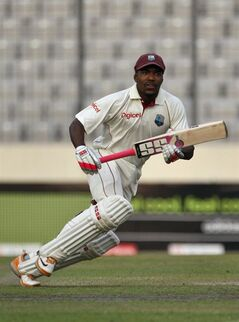 West Indies batsman Darren Bravo scores a run to make his century during the third day of the second cricket test match against Bangladesh in Dhaka, Bangladesh, Monday, Oct. 31, 2011. (AP Photo/Pavel Rahman)
