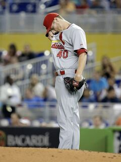 St. Louis Cardinals starting pitcher Shelby Miller wipes his face after giving up a two-run home run and a single in the first inning during a baseball game against the Miami Marlins, Monday, Aug. 11, 2014, in Miami. (AP Photo/Lynne Sladky)