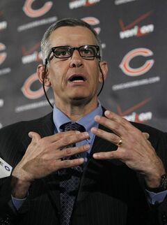 Phil Emery, the new Chicago Bears general manager, talks with reporters during his first news conference as general manager, Monday, Jan. 30, 2012, in Lake Forest, Ill. (AP Photo/Charles Rex Arbogast)