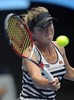 Elina Svitolina of Ukraine hits a forehand return to Sloane Stephens of the U.S. during their third round match at the Australian Open tennis championship in Melbourne, Australia, Saturday, Jan. 18, 2014. (AP Photo/Andrew Brownbill)