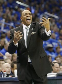FILE - In this May 5, 2013 file photo, Memphis Grizzlies head coach Lionel Hollins gestures during Game 1 of their Western Conference Semifinals NBA basketball playoff series against the Oklahoma City Thunder in Oklahoma City. The Brooklyn Nets say they have reached an agreement in principle with Hollins to become their coach, moving quickly after the departure of Jason Kidd. The deal with the former Grizzlies coach comes just two days after they made a trade with Milwaukee to allow Kidd out of his contract so the Bucks could hire him. The Nets then met with Hollins on Monday night and again Tuesday before agreeing to the deal on Wednesday, July 2, 2014.(AP Photo/Sue Ogrocki, File)