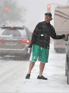 Saskatchewan fan Dennis Maione was spotted dashing across Portage Avenue Saturday morning. as snow and blowing snow made for low visibility.