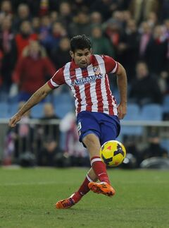 Atletico's Diego Costa scores his goal during a Spanish La Liga soccer match between Atletico de Madrid and Real Sociedad at the Vicente Calderon stadium in Madrid, Spain, Sunday, Feb. 2, 2014. (AP Photo/Andres Kudacki)