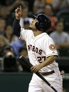 Houston Astros' Jose Altuve points upward after scoring against the Texas Rangers on a George Springer single in the fourth inning of a baseball game Tuesday, May 13, 2014, in Houston. (AP Photo)