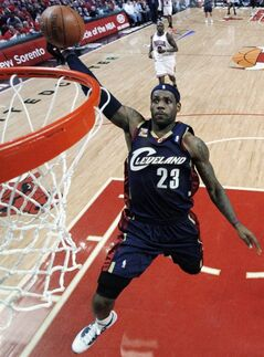 FILE - IN this April 22, 2010, file photo, Cleveland Cavaliers' LeBron James dunks against the Chicago Bulls during the second quarter of Game 3 of a first-round NBA basketball playoff series in Chicago. James told Sports Illustrated on Friday, July 11, 2014, he is leaving the Miami Heat to go back to the Cleveland Cavaliers. (AP Photo/Charles Cherney, File)