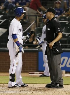 Texas Rangers' Leonys Martin argues a strike three call that ended the game with home plate umpire Gabe Morales at the conclusion of the ninth inning of a baseball game against the Tampa Bay Rays, Thursday, Aug. 14, 2014, in Arlington, Texas. Tampa bay won 6-3. (AP Photo/Brandon Wade)