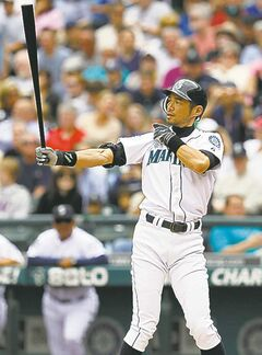 Seattle Mariners' Ichiro Suzuki gives a tug to his jersey sleeve, as he does every at-bat, while stepping in against the Texas Rangers in the first inning of a baseball game Sunday, July 15, 2012, in Seattle. Suzuki flied out on the turn. (AP Photo/Elaine Thompson)
