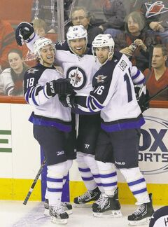 Both Bryan Little (left) and Blake Wheeler (centre), seen here with linemate Andrew Ladd, filed for arbitration Thursday.
