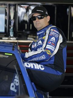 Jeff Gordon climbs into his car before practice for the NASCAR Sprint Cup Series auto race on Friday, June 20, 2014, in Sonoma, Calif. (AP Photo/Eric Risberg)