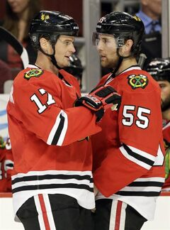 Chicago Blackhawks' Sheldon Brookbank, left, talks with Ryan Stanton during the second period of an NHL preseason hockey game against the Pittsburgh Penguins in Chicago, Thursday, Sept. 19, 2013. (AP Photo/Nam Y. Huh)