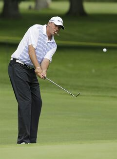 Former NBA basketball player Toni Kukoc chips to the first hole during the first round of the Encompass Championship golf tournament in Glenview, Ill., Friday, June 20, 2014. (AP Photo/Nam Y. Huh)