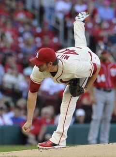 St. Louis Cardinals' starting pitcher Shelby Miller follows through on a delivery to the Washington Nationals in the first inning in a baseball game, Saturday, June 14, 2014, at Busch Stadium in St. Louis. (AP Photo/Bill Boyce)