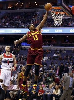 Cleveland Cavaliers forward Tristan Thompson (13) dunks in front of Washington Wizards center Marcin Gortat (4), from Poland, in the first half of an NBA basketball game on Friday, Feb. 7, 2014, in Washington. (AP Photo/Alex Brandon)
