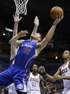 Los Angeles Clippers' Blake Griffin (32) puts up a shot against Milwaukee Bucks' Ersan Ilyasova, back, during the first half of an NBA basketball game, Monday, Jan. 27, 2014, in Milwaukee. (AP Photo/Jeffrey Phelps)