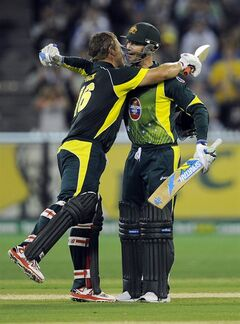 Australia's Aaron Finch, left, celebrates with his captain Michael Clarke, right, after making 100 runs against England during their one-day international cricket match at the Melbourne Cricket Ground in Melbourne, Australia, Sunday, Jan. 12, 2014. (AP Photo/Andy Brownbill)