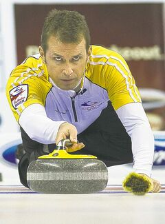Manitoba skip Jeff Stoughton throws his rock while playing against Ontario during final game action at the Brier Canadian Curling Championships in London, Ont., on Sunday, March 13, 2011.  THE CANADIAN PRESS/Nathan Denette