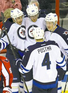 Winnipeg Jets right wing Nik Antropov (80) celebrates with teammates after scoring in the third period Tuesday.