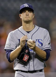 Tampa Bay Rays starting pitcher Jake Odorizzi pauses in the third inning of a baseball game against the Baltimore Orioles, Monday, Aug. 25, 2014, in Baltimore. Baltimore scored three runs in the third. (AP Photo/Patrick Semansky)