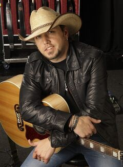 FILE - In this March 3, 2009 file photo, country music performer Jason Aldean poses for a photo in Nashville, Tenn. Aldean has the second most ACM nominations behind Kenny Chesney, with six, including entertainer and album of the year. (AP Photo/Mark Humphrey, File)