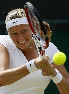 ADVANCE FOR WEEKEND EDITIONS, JUNE 21-22 - FILE - In this July 1, 2013, file photo, Petra Kvitova, of the Czech Republic, returns to Carla Suarez Navarro, of Spain, during a women's singles match at the All England Lawn Tennis Championships in Wimbledon, London. (AP Photo/Kirsty Wigglesworth, File)