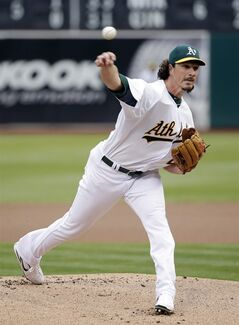 Oakland Athletics starting pitcher Jeff Samardzija throws to the Minnesota Twins during the first inning of a baseball game on Saturday, Aug. 9, 2014, in Oakland, Calif. (AP Photo/Marcio Jose Sanchez)