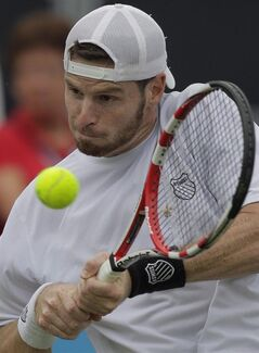 Pierre-Ludovic Duclos of Canada returns in his match against David Ferrer of Spain at the Unicef Open grass court tennis tournament in Rosmalen, central Netherlands, Tuesday, June 19, 2012. A Quebec tennis player facing five charges for allegedly soliciting sex from a 13-year-old girl has been released on bond from a Florida jail. THE CANADIAN PRESS/AP/Peter Dejong