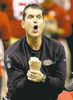 49ers head coach Jim Harbaugh protests what he thinks is a missed interference call late in the fourth quarter.