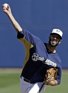 Milwaukee Brewers' Mike Fiers throws before the first inning of an exhibition spring training baseball game against the Oakland Athletics on Saturday, Feb. 23, 2013, in Phoenix. (AP Photo/Morry Gash)