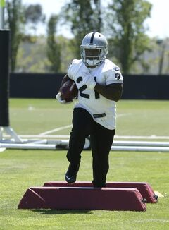 Oakland Raiders running back Maurice Jones-Drew carries the ball during a drill at the Raiders mini-camp in Alameda, Calif., Tuesday, June 17, 2014.(AP Photo/Rich Pedroncelli)