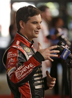 Driver Jeff Gordon answers questions during NASCAR auto racing media day at Daytona International Speedway in Daytona Beach, Fla., Thursday, Feb. 13, 2014. (AP Photo/John Raoux)