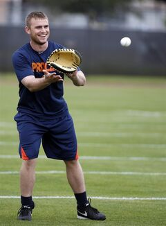 Houston Astros catcher Max Stassi prepares to catch the all during a spring training baseball workout, Saturday, Feb. 15, 2014, in Kissimmee, Fla. (AP Photo/Alex Brandon)