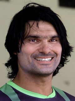 Pakistani fast bowler Mohammad Irfan listens to a reporters question at Qaddafi stadium in Lahore, Pakistan, Tuesday, June 3, 2014. Irfan is focusing on next year's World Cup and wants to concentrate on one-day internationals and Twenty20s ahead of 2015 mega event in Australia and New Zealand. (AP Photo/K.M. Chaudary)