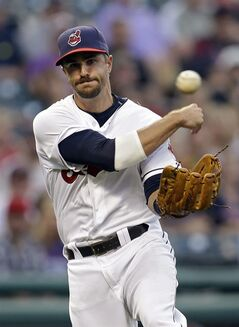 Cleveland Indians third baseman Lonnie Chisenhall throws to first but can't get Houston Astros' Jake Marisnick on an infield single in the third inning of a baseball game Friday, Aug. 22, 2014, in Cleveland. (AP Photo/Mark Duncan)