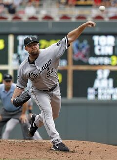 Chicago White Sox starting pitcher John Danks delivers to the Minnesota Twins during the first inning of a baseball game in Minneapolis, Sunday, June 22, 2014. (AP Photo/Ann Heisenfelt)